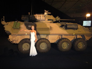 Eat Pray Workout Australia top health blogger Amy Darcy with army tank at military ball