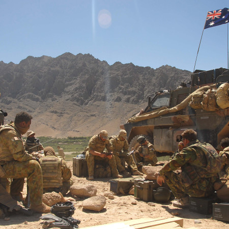 Australian Army service members and tank in Afganistan