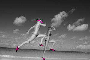 females wearing barefoot running shoes on beach