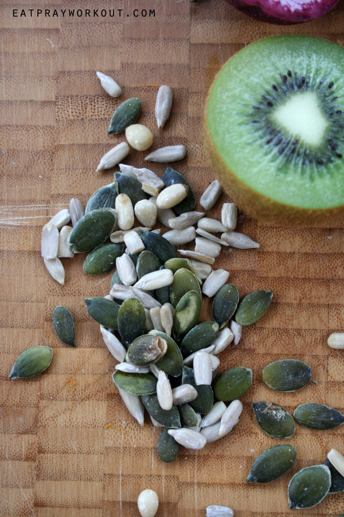 tropical paw paw plate  breakfast kiwifruit sunflower seeds and pepitas