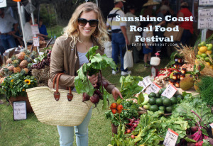 Eat Pray Workout Australia top health blogger Amy Darcy with fresh produce at sunshine coast real food festival