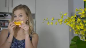 Amy Darcy Eat Pray Workout Australia top health blog in kitchen with wattle smiling with orange