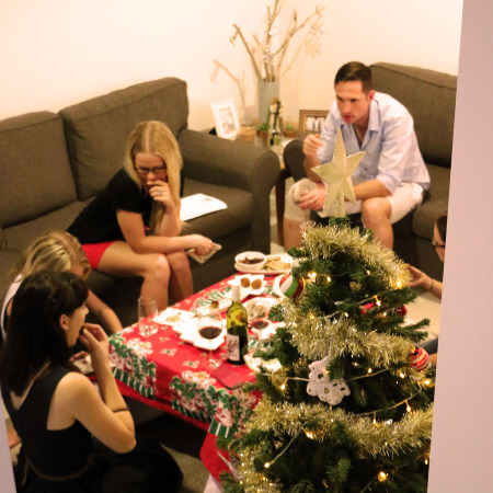 Group of friends eating Mushroom canapes at Christmas time