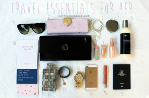 travel essentials for her sunglasses travel wallet headphones compact mirror hand and body lotion toner eye cream lip blam passport holder burberry perfume bracelet jewellery watch iPhone lip colour passport