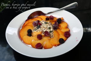 Peaches, Berries and Muesli on a bed of yogurt