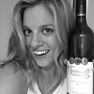 Amy Darcy Australia top health blogger from Eat Pray Workout with bottle of red wine at restuarant