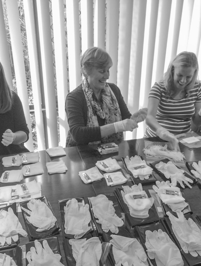 Woman at baby shower packing birth kits for world vision sister