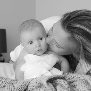 Amy Darcy Australia top health blogger from Eat Pray Workout and baby boy son Finn kissing in black and white
