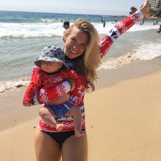 Amy Darcy, Australia top health blogger from Eat Pray Workout with baby boy Finn on holiday at Cronulla beach, Finn's first time at the beach wearing Cancer Council Christmas sun protection at Cronulla