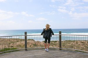 Amy Darcy, Australia top health blogger, Eat Pray Workout, on holiday at Cronulla beach wearing activewear, exercising on sunny day
