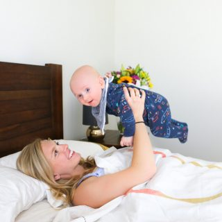 Blogger mum Amy from Eat Pray Workout Australia top health blogger playing with baby boy Finn in bed on ergoflex pillow