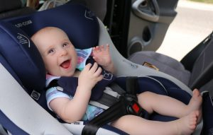 Smiling baby boy Finn travelling in maxi cosi car seat