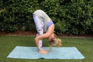 Amy, Australia top health blogger from Eat Pray Workout doing yoga poses for flexibility and balance in we are handsome exercise leggings in the garden