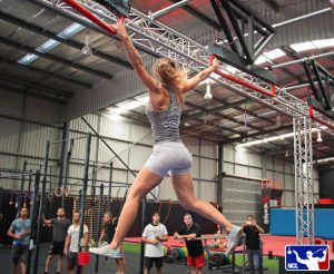 female for obstacle training aussie ninja warrior at gym and NCL logo