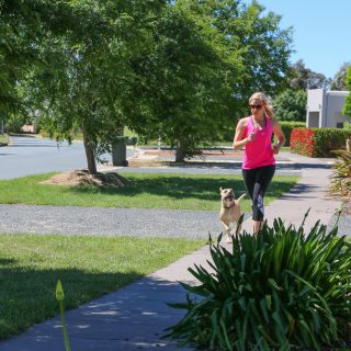 Australia top health blogger Amy from Eat Pray Workout training and running in neighbourhood street with Honey the dog