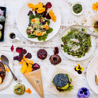 large vegan dessert and snack selection with edible flowers