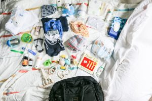 Nappy Bag with clothing, nappies, wipes, book, toys, medicine, sippy cup, spoon and MooGoo baby products