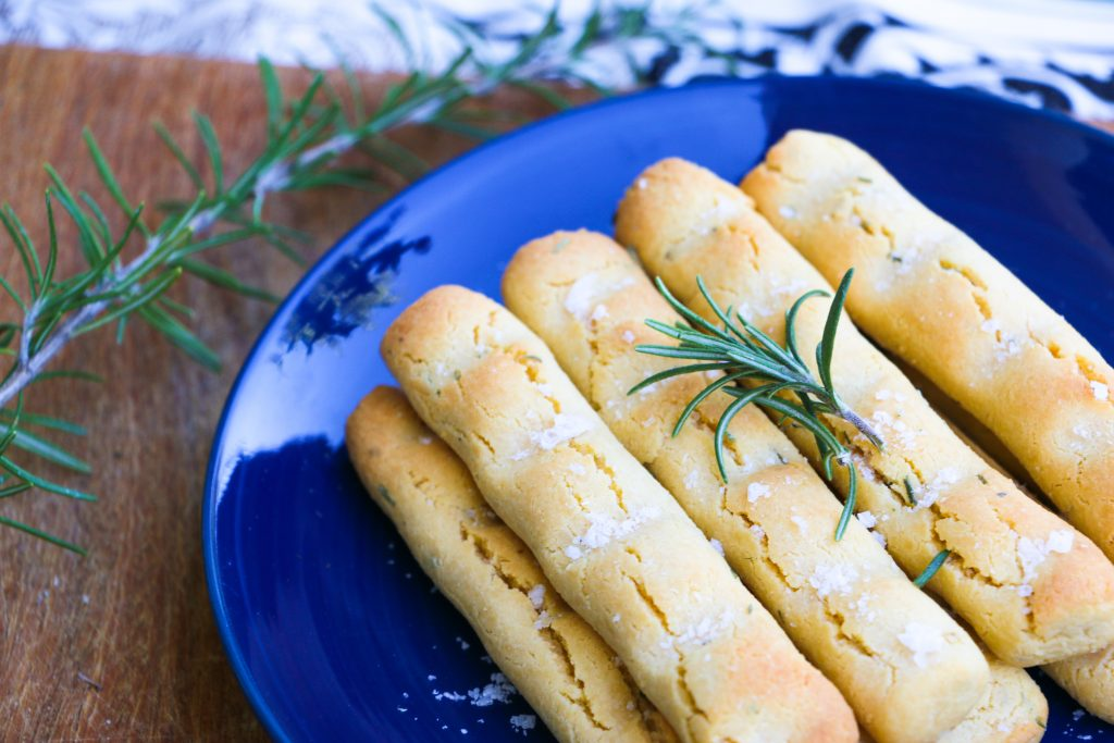 rosemary and garlic paleo breadsticks on dining table