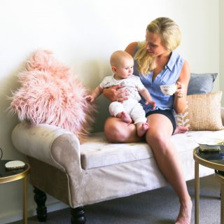 amy darcy australian health blogger tea on couch with finn motherhood
