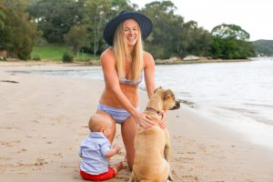 Amy Darcy Australian health blogger fit bikini body post baby Sydney beach with dog and baby Finn