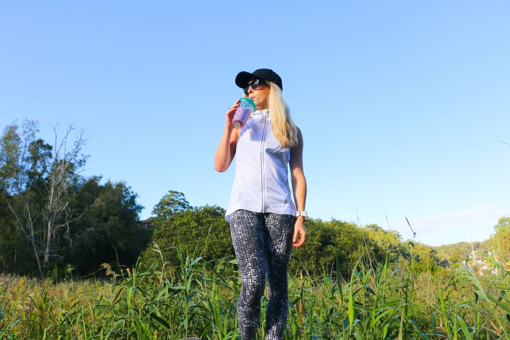 amy darcy australian health blogger blonde sipping vitasoy outside