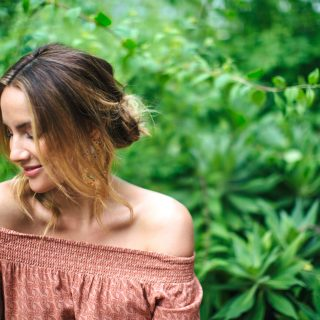 Model and dancer Rachael Finch smiling in garden interview for Eat Pray Workout