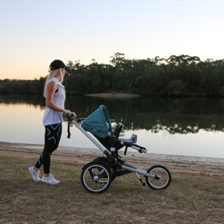 Mum Amy Australian top health blogger with baby in bugaboo runner pram stroller outside