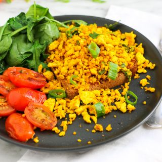 Fresh scrambled tofu made with vitasoy almond milk on toast with salad of cherry tomatoes and green leafy vegetables for Eat Pray Workout, Australian top health blog