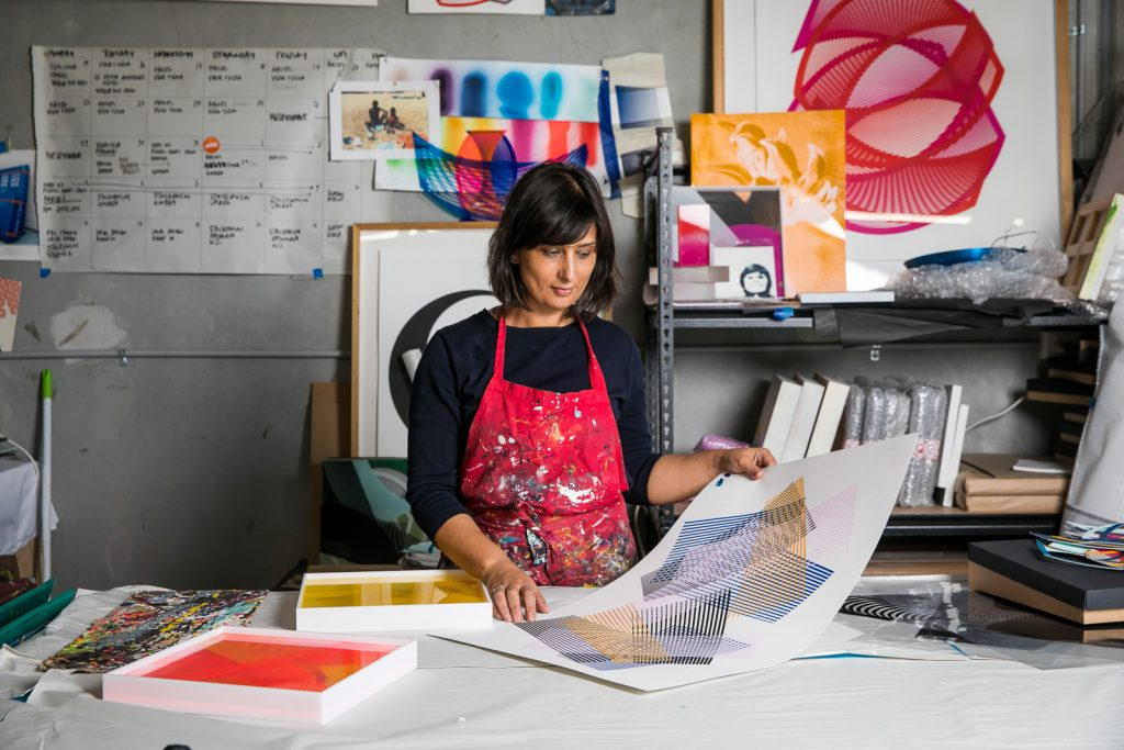 Artist Kate Banazi in her art screen printing studio