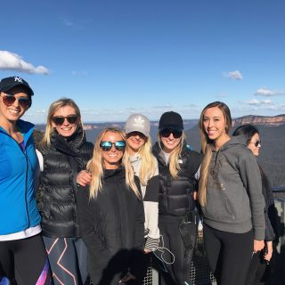 australia's top food and wellness health blogger girls exercising and smiling at the Three Sisters Blue Mountains