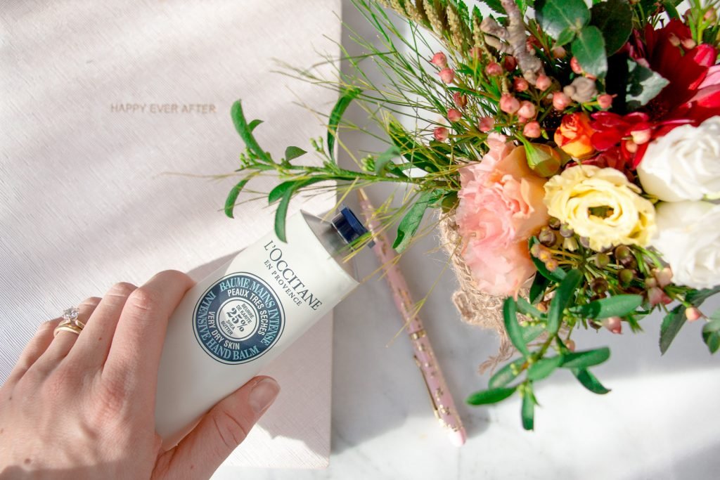 l'occitane shea butter hand cream review for winter skincare beauty essentials with flowers and book