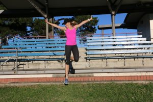 amy jumping off stairs happy joy in pink top
