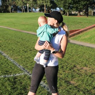 Eat Pray Workout Australia top health blogger parent Amy Darcy with baby boy Finn on sports field