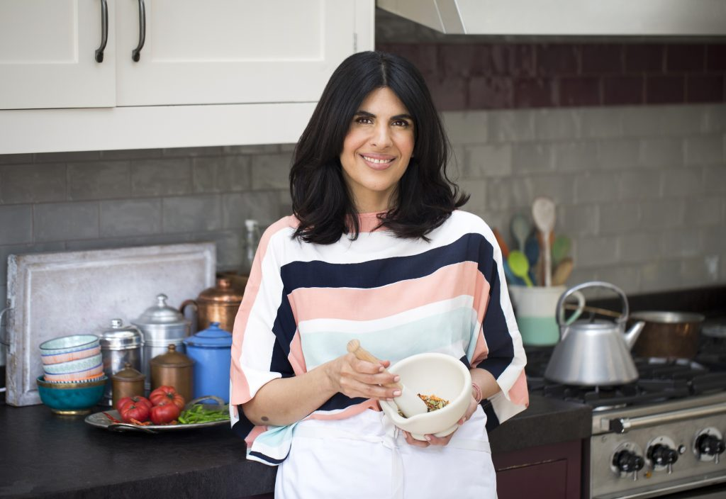 how to make indian healthier with celebrity chef Anjum Anand cooking in kitchen