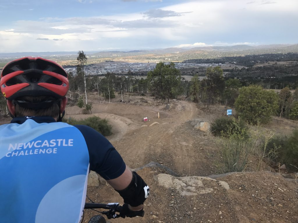 Male mountain bike rider in Canberra looking down the Enduro track at Stromlo