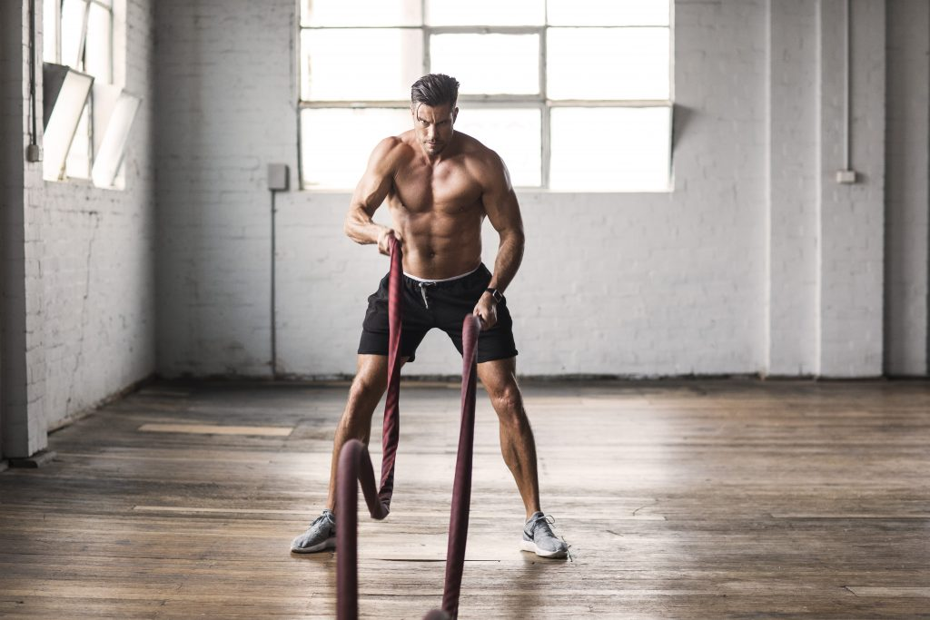 sam wood shirt off with battle ropes
