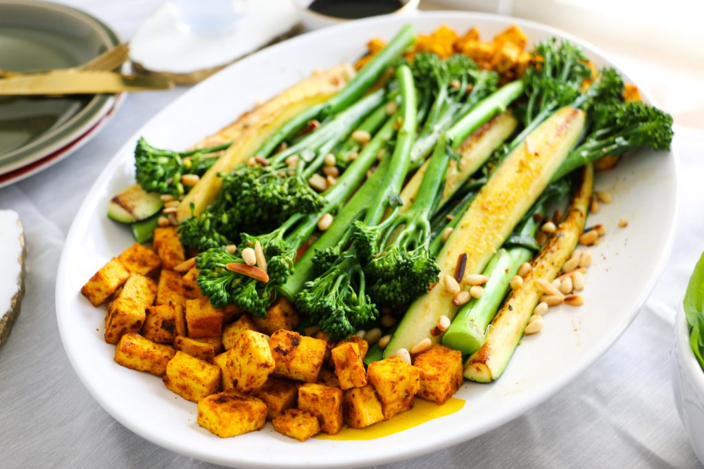 Broccolini, Zuchinni & Tumeric Tofu Salad on a platter