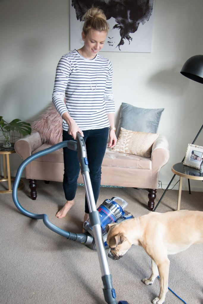 home solutions and remedies for hayfever sufferers - amy vacuuming with honey dog eat pray workout