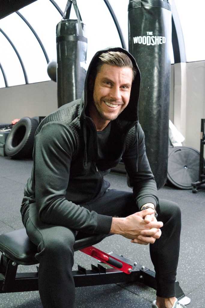 bachelor sam wood in gym smiling