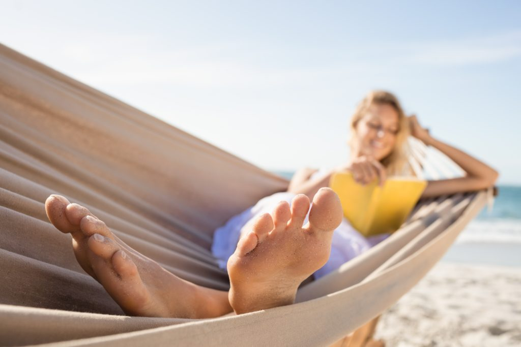 spiritual health weight management and body image woman reading bible in hammock