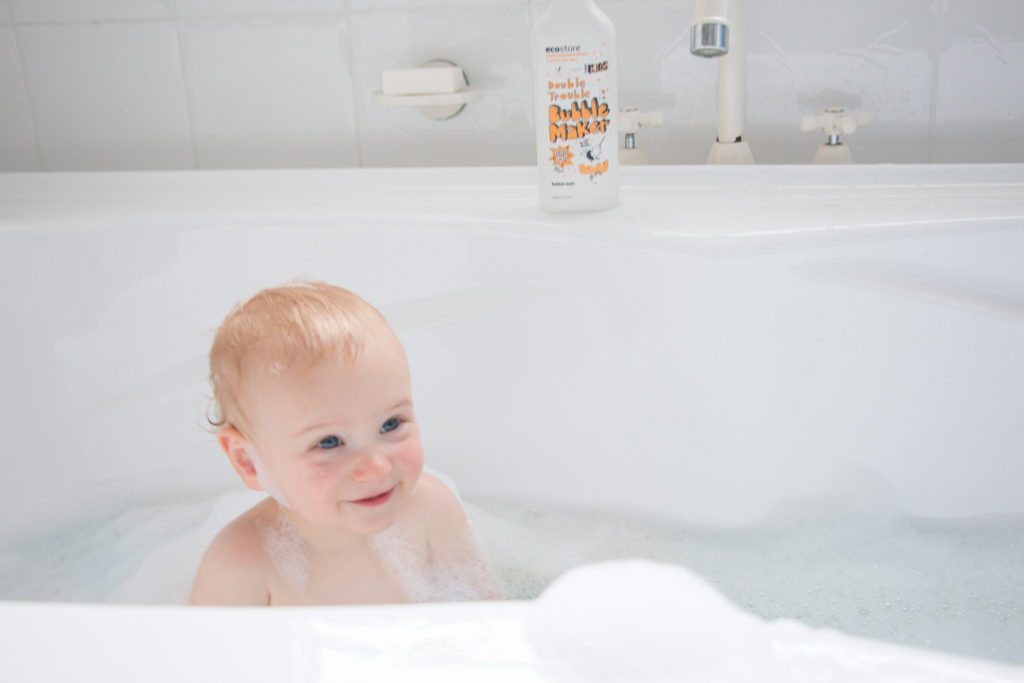 simple bed time rituals for toddlers toddler Finn sitting in bubble bath smiling