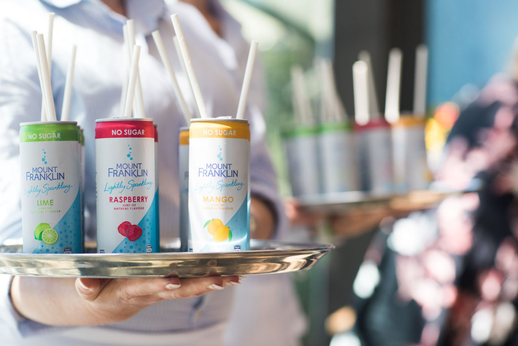 mount franklin lightly sparkling cans at launch lunch with Jennifer Hawkins