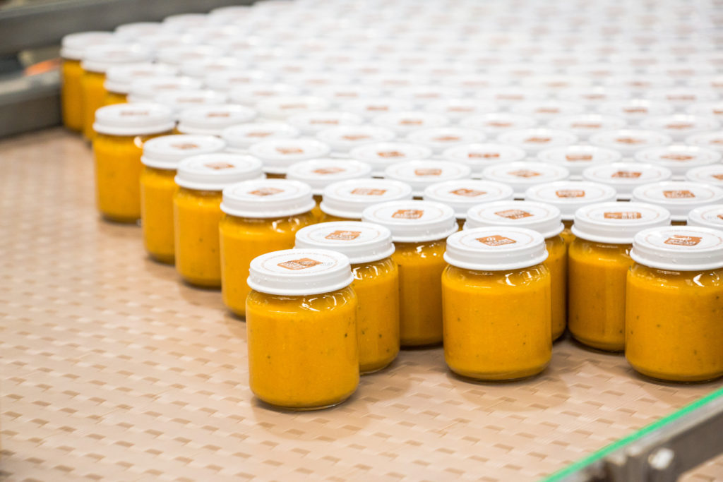 heinz infant food factory baby food in jars ready to be labelled