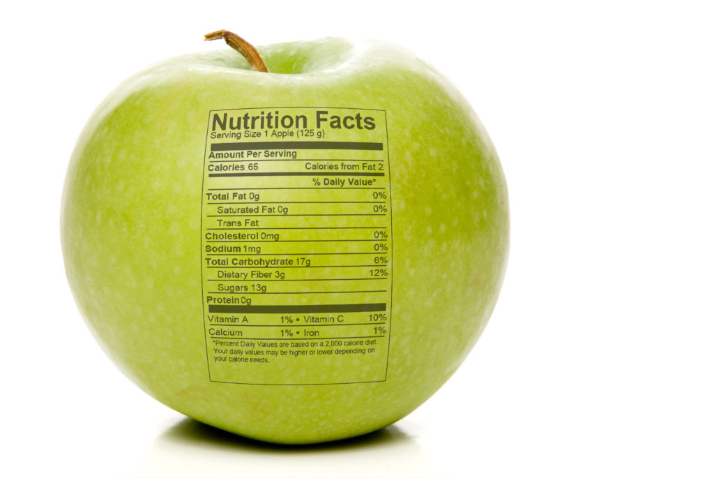 The nutrition facts stamped on an apple. Reading food labels in australia