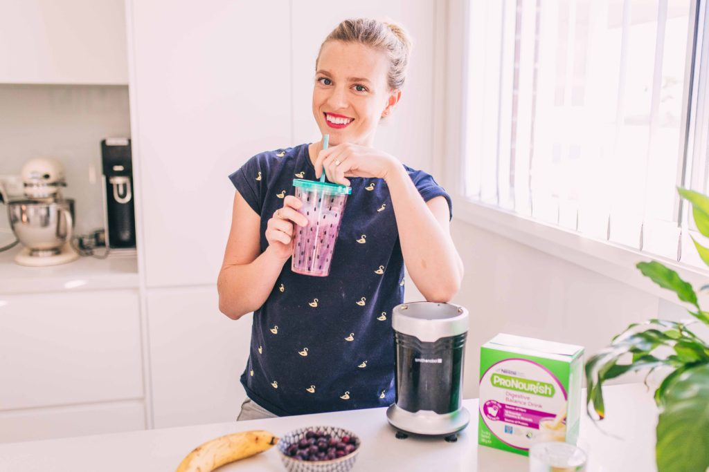 How to reduce your bloating, gas and manage your IBS symptoms enjoy pronouish supplement as snack amy darcy in kitchen
