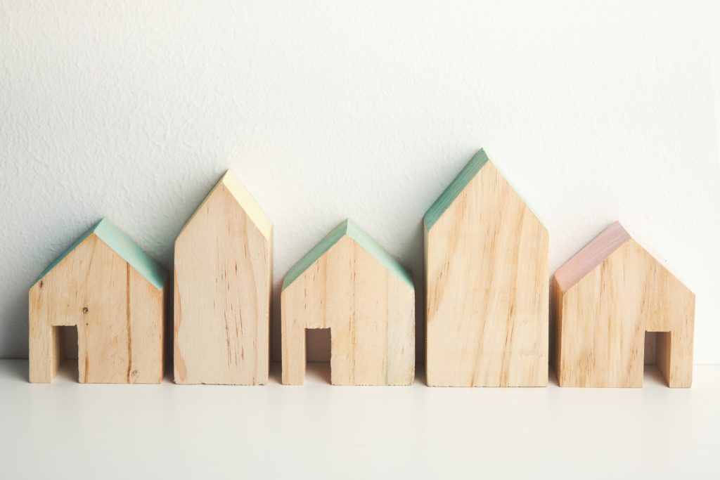 Set of natural wood house shaped baby toys - how to improve your wellbeing by bringing nature indoors for kids
