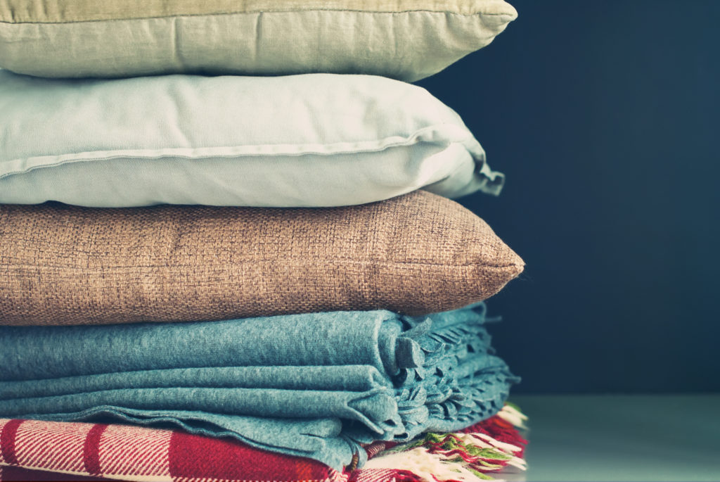 How to improve your wellbeing by bringing nature indoor - linen and wool natural fibres