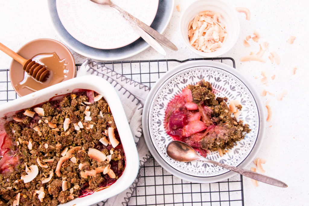 Healthy Dessert Recipe with Banana Flour - Rhubarb, Pistachio and Ginger Crumble served on plate with baking dish next to it