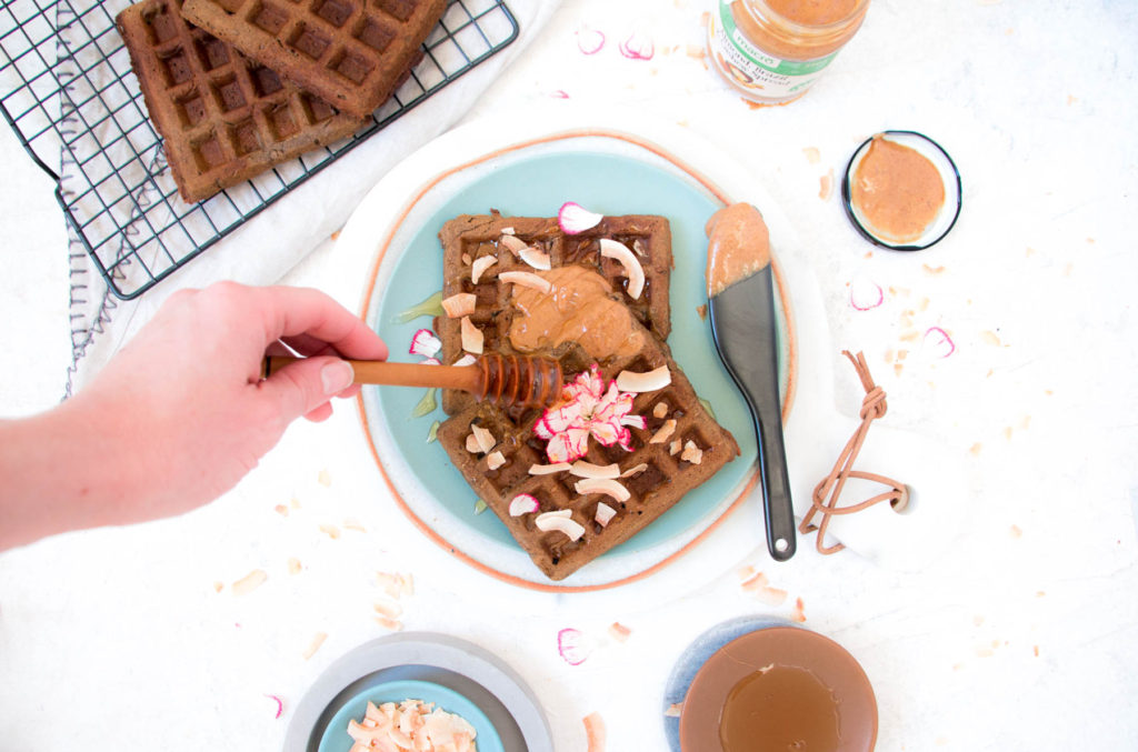 Healthy Banana Flour Protein Waffles with nut butter, honey and coconut