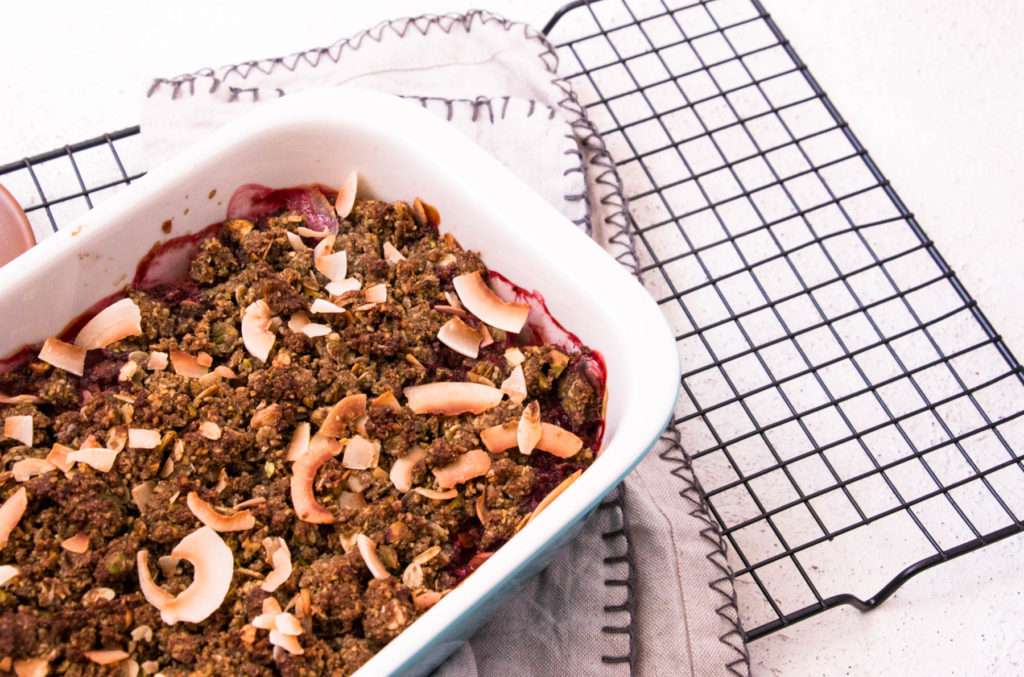 Healthy Dessert Recipe with Banana Flour - Rhubarb, Pistachio and Ginger Crumble in baking dish